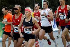 Spanish former world steeplechase champion Marta Dominguez (3rd L) takes part in the Divina Pastora 10 km road race in Madrid October 30, 2011. REUTERS/Susana Vera