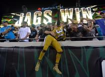 Nov 19, 2015; Jacksonville, FL, USA; Jacksonville Jaguars cornerback Davon House (31) celebrates with fans after an NFL football game against the Tennessee Titans at EverBank Field. The Jaguars defeated the Titans 19-13. Mandatory Credit: Kirby Lee-USA TODAY Sports