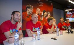 Belgian Davis Cup team (from left to right) Michael Llodra, Johan Van Herck (captain), David Goffin, Steve Darcis, Ruben Bemelman and Kimmer Coppejans holds a news conference ahead of the final against Britain in Brussels, Belgium, November 17, 2015. REUTERS/Delmi Alvarez