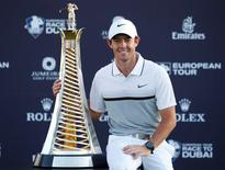Golf - DP World Tour Championship - Jumeirah Golf Estates, Dubai, United Arab Emirates - 22/11/15 Northern Ireland's Rory McIlroy celebrates with the trophy after winning The Race to Dubai Action Images via Reuters / Paul Childs Livepic