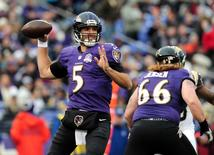 Nov 22, 2015; Baltimore, MD, USA; Baltimore Ravens quarterback Joe Flacco (5) throws a pass in the third quarter against the St. Louis Rams at M&T Bank Stadium. The Ravens won 16-13. Mandatory Credit: Evan Habeeb-USA TODAY Sports
