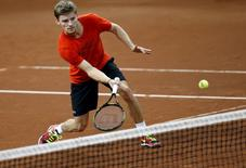 Belgium's David Goffin returns volley during a training session ahead of the Davis Cup final between Belgium and Britain at Flanders Expo hall in Ghent, Belgium, November 24, 2015.   REUTERS/Francois Lenoir