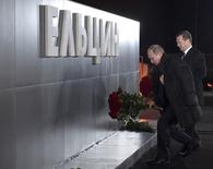 Russian President Vladimir Putin (L) and Prime Minister Dmitry Medvedev lay flowers at a monument of first Russian President Boris Yeltsin in Yekaterinburg, Russia November 25, 2015.  REUTERS/Alexander Astafyev/Sputnik/Pool ATTENTION EDITORS - THIS IMAGE HAS BEEN SUPPLIED BY A THIRD PARTY. IT IS DISTRIBUTED, EXACTLY AS RECEIVED BY REUTERS, AS A SERVICE TO CLIENTS. - RTX1VSDE