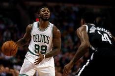Nov 20, 2015; Boston, MA, USA; Boston Celtics forward Jae Crowder (99) looks for an opening past Brooklyn Nets guard Rondae Hollis-Jefferson (24) during the second half at TD Garden. The Celtics defeated the Nets 120-95. Mandatory Credit: David Butler II-USA TODAY Sports
