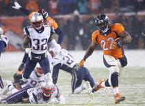 Denver Broncos running back C.J. Anderson (22) runs for the game winning touchdown during the overtime period against the New England Patriots at Sports Authority Field at Mile High. The Broncos won 30-24. Mandatory Credit: Chris Humphreys-USA TODAY Sports