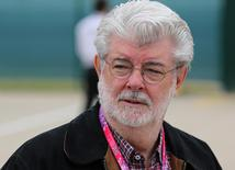 Film director George Lucas walks through the pit area prior to the Formula One British Grand Prix 2015 in Silverstone, England in this July 5, 2015 file photo.   REUTERS/Paul Childs/Files