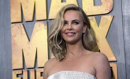"""Cast member Charlize Theron poses at the premiere of """"Mad Max: Fury Road"""" in Hollywood, California May 7, 2015. The movie opens in the U.S. on May 15.  REUTERS/Mario Anzuoni"""