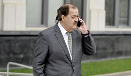 Former Massey Energy Chief Executive Don Blankenship is talking on his mobile phone as he walks into the Robert C. Byrd U.S. Courthouse in Charleston, West Virginia December 3, 2015. REUTERS/Chris Tilley