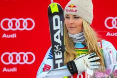First place finisher Lindsey Vonn of the United States takes the podium during the women's Super G race in the FIS alpine skiing World Cup at Lake Louise Ski Resort.  Sergei Belski-USA TODAY Sports