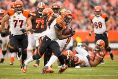 Cincinnati Bengals running back Jeremy Hill (32) runs the ball for a gain of 17 yards against the Cleveland Browns during the third quarter at FirstEnergy Stadium. Scott R. Galvin-USA TODAY Sports