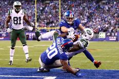 Dec 6, 2015; East Rutherford, NJ, USA; New York Jets wide receiver Brandon Marshall (15) catches a game-tying touchdown in front of New York Giants corner back Prince Amukamara (20) and New York Giants safety Craig Dahl (43) during the fourth quarter at MetLife Stadium. The Jets defeated the Giants 23-20 in overtime. Mandatory Credit: Brad Penner-USA TODAY Sports