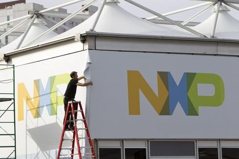 NXP completes deal to buy Freescale and create top auto chipmaker