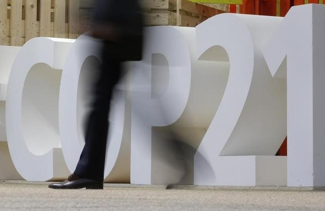 A man walks past a logo at the climate Generations area at the World Climate Change Conference 2015 (COP21) at Le Bourget, near Paris, France, December 1, 2015.     REUTERS/Christian Hartmann