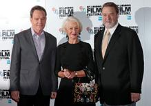 "Actors Bryan Cranston (L), Helen Mirren and John Goodman pose for photographers during a photo call for the film ""Trumbo"" in London, Britain October 8, 2015. REUTERS/Suzanne Plunkett"