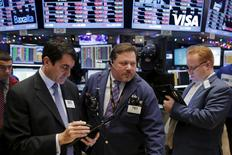 Traders work shortly after the opening bell on the floor of the New York Stock Exchange in the Manhattan borough of New York, December 8, 2015. REUTERS/Lucas Jackson