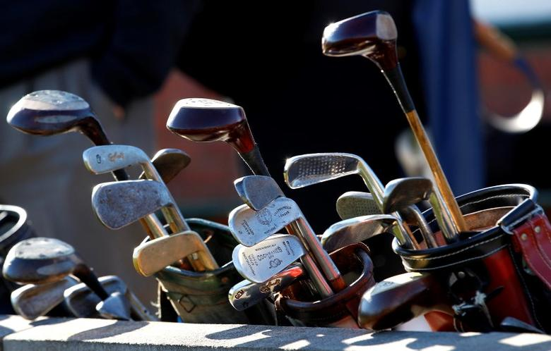 Sets of hickory golf clubs sit outside a clubhouse during the World Hickory Open Golf Championship at Monifeith Links golf course in Monifeith, north east Scotland in this file photo dated October 8, 2012. REUTERS/David Moir