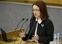 Russian Central Bank Governor Elvira Nabiullina addresses deputies during a session of the State Duma, the lower house of parliament, in Moscow, Russia, November 13, 2015. Russia's central bank sees scope for further rate cuts in its base scenario and is ready to sell foreign currency on the market in case of a threat to the financial stability, governor Elvira Nabiullina said on Friday. REUTERS/Sergei Karpukhin
