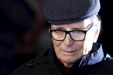 """Composer Ennio Morricone poses as he arrives for the European premiere of """"The Hateful Eight"""" at Leicester Square in London, Britain, December 10, 2015. REUTERS/Luke MacGregor"""