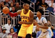Dec 11, 2015; Orlando, FL, USA; Cleveland Cavaliers forward LeBron James (23) dribbles the ball as Orlando Magic guard Elfrid Payton (4) defends during the second half at Amway Center. The Cavaliers won 111-76. Mandatory Credit: Kim Klement-USA TODAY Sports