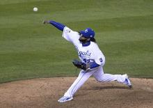 Oct 28, 2015; Kansas City, MO, USA; Kansas City Royals starting pitcher Johnny Cueto throws a pitch against the New York Mets in the 9th inning in game two of the 2015 World Series at Kauffman Stadium. Mandatory Credit: John Rieger-USA TODAY Sports