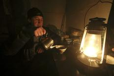 Ravshan, a Crimean Tatar, uses a burning oil lamp due to a power cut inside his house in the village of Strogonovka, Simferopol district, Crimea, November 26, 2015. Power blackouts in Crimea orchestrated by anti-Russian saboteurs are stirring discontent a year and a half after Moscow seized the peninsula from Ukraine, threatening to chip away at the pro-Kremlin euphoria many Crimeans felt after annexation. REUTERS/Pavel Rebrov