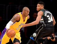 Dec 15, 2015; Los Angeles, CA, USA; Milwaukee Bucks forward Giannis Antetokounmpo (34) defends Los Angeles Lakers forward Kobe Bryant (24) as he drives to the basket in the first quarter of the game at Staples Center. Mandatory Credit: Jayne Kamin-Oncea-USA TODAY Sports