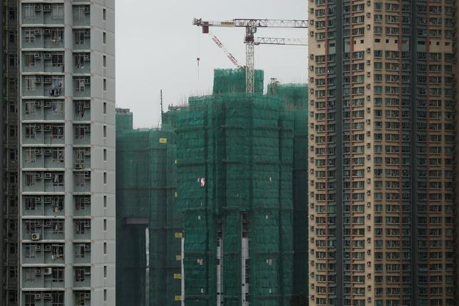 Construction cranes are seen at the building site of a new private housing complex in Hong Kong, China December 15, 2015. REUTERS/Tyrone Siu