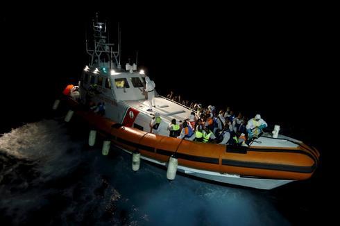 'No fingerprints!' chant migrants in Italy as EU cracks down