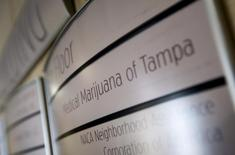 An office building sign directs visitors to Florida's first marijuana business school, Medical Marijuana Tampa, in Tampa, Florida May 6, 2014.   REUTERS/Scott Audette