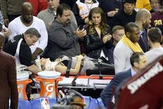 Dec 17, 2015; Cleveland, OH, USA; Ellie Day, wife of golfer Jason Day (not pictured), leaves the arena on a stretcher after she was run into by Cleveland Cavaliers forward LeBron James (not pictured) while she sat in the front row during a game between the Cleveland Cavaliers and the Oklahoma City Thunder at Quicken Loans Arena. Mandatory Credit: David Richard-USA TODAY Sports