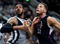 Dec 18, 2015; San Antonio, TX, USA; Los Angeles Clippers forward Blake Griffin (32) and San Antonio Spurs forward LaMarcus Aldridge (12) fight for position under the basket at the AT&T Center. San Antonio won 115-107. Mandatory Credit: Erich Schlegel-USA TODAY Sports