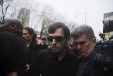 Martin Shkreli (C) departs the U.S. Federal Court after an arraignment following him being charged in a federal indictment filed in Brooklyn relating to his management of hedge fund MSMB Capital Management and biopharmaceutical company Retrophin Inc. in New York December 17, 2015. REUTERS/Lucas Jackson