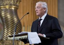 Former Montreal Canadiens teammate Dickie Moore speaks at the funeral for former Montreal Canadiens captain Jean Beliveau at Mary Queen of the World Cathedral in Montreal, December 10, 2014.  REUTERS/Paul Chiasson