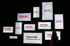 A visitor looks at a display of Japan's Toshiba company during the IFA Electronics show in Berlin, Germany in this September 4, 2014 file photo.  REUTERS/Hannibal Hanschke/Files