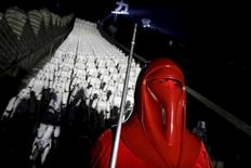 "A fan dressed as a character from ""Star Wars"" poses for a photo in front of five hundred replicas of the Stormtrooper characters at the Juyongguan section of the Great Wall of China during a promotional event for ""Star Wars: The Force Awakens"" film, on the outskirts of Beijing, China, October 20, 2015. REUTERS/Jason Lee/Files"