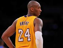 Dec 23, 2015; Los Angeles, CA, USA; Los Angeles Lakers forward Kobe Bryant (24) during the fourth quarter against the Oklahoma City Thunder at Staples Center. Mandatory Credit: Robert Hanashiro-USA TODAY Sports