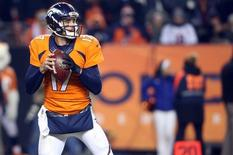 Dec 28, 2015; Denver, CO, USA; Denver Broncos quarterback Brock Osweiler (17) looks to pass the ball during the second half against the Cincinnati Bengals at Sports Authority Field at Mile High.  Mandatory Credit: Chris Humphreys-USA TODAY Sports