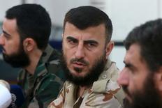 """Лидер сирийской повстанческой группировки """"Джаиш аль-Ислам"""" Захран Аллуш на пресс-конференции в городе Дума. 27 августа 2014 года. Саудовская Аравия осудила во вторник убийство одного из видных лидеров сирийских повстанцев, сказав, что его гибель в результате российского авиаудара на прошлой неделе не пошла на пользу установлению мира в Сирии. REUTERS/Bassam Khabieh"""