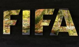 FIFA's logo is seen in front of its headquarters during a meeting of the FIFA executive committee in Zurich, Switzerland September 25, 2015. REUTERS/Arnd Wiegmann