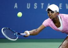 Victoria Duval of the U.S. reaches for a forehand during her loss to Daniela Hantuchova of Slovakia at the U.S. Open tennis championships in New York, August 29, 2013. REUTERS/Eduardo Munoz