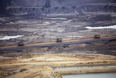 Giant dump trucks haul raw tar sands at the Syncrude tar sands operations near Fort McMurray, Alberta, September 17, 2014.   REUTERS/Todd Korol