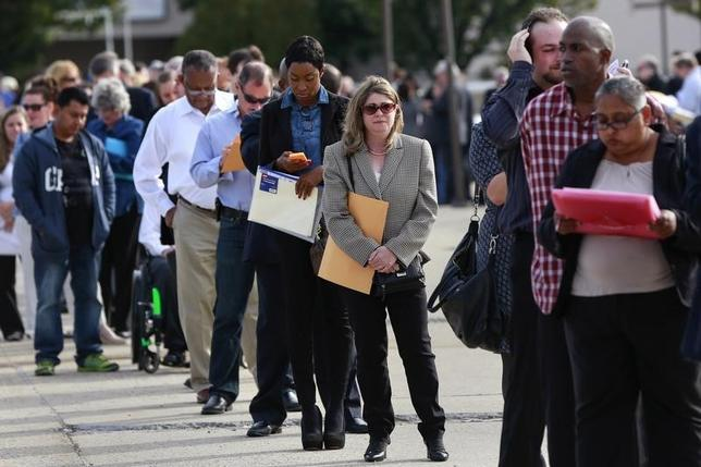 People wait in line to enter the Nassau County Mega Job Fair at Nassau Veterans Memorial Coliseum in Uniondale, New York October 7, 2014. REUTERS/Shannon Stapleton/Files