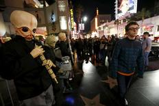 """People dressed as the fictional band Figrin D'an and the Modal Nodes stand before the first showing of the movie """"Star Wars: The Force Awakens"""" at the TCL Chinese Theatre in Hollywood, California, December 17, 2015.    REUTERS/Mario Anzuoni"""
