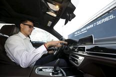 BMW's Vlatko Kalinic demonstrates a gesture control feature to control the radio volume in a 2016 BMW 750i sedan during the 2016 CES trade show in Las Vegas, Nevada January 7, 2016. REUTERS/Steve Marcus