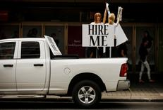 """Motorized mannequins hold signs that read """"Hire Me"""" in Toronto May 23, 2014.  REUTERS/Mark Blinch"""