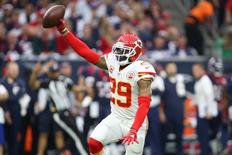 Jan 9, 2016; Houston, TX, USA; Kansas City Chiefs free safety Eric Berry (29) reacts after intercepting a pass against the Houston Texans during the first quarter in a AFC Wild Card playoff football game at NRG Stadium. Mandatory Credit: Troy Taormina-USA TODAY Sports