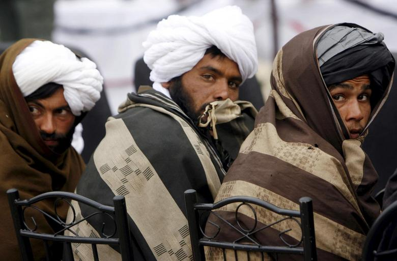 Afghan Taliban look on after handing over their weapons as they join the Afghan government's reconciliation and reintegration program in Herat province in this February 17, 2013 file photo.  REUTERS/Mohmmad Shoib/Files