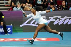 Manila Mavericks player Serena Williams of the United States returns the ball against the Legendari Japan Warriors player Mirjana Lucic-Baroni of Germany  during their women's singles match in the International Premier Tennis League in Pasay City, Philippines, on December 7, 2015.  REUTERS/Czar Dancel