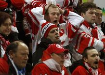 Fans of Spartak Moscow react during an ice hockey game against HC Geneve Servette at the Spengler Cup tournament in the Swiss mountain resort of Davos December 29, 2010. HC Geneve Servette won the game.  REUTERS/Arnd Wiegmann (SWITZERLAND - Tags: SPORT ICE HOCKEY) - RTXW2U8