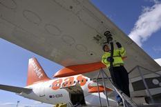 A worker fills the fuel tank on an EasyJet Airbus aircraft  in Ljubljana's airport Brnik February 16, 2012. REUTERS/Srdjan Zivulovic